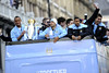 Vincent Kompany holds the trophey Manchester City Premier League Title victory parade. Players and staff of Manchester City parade the English Premier League Trophy through the city centre from an open-top bus. Manchester, England