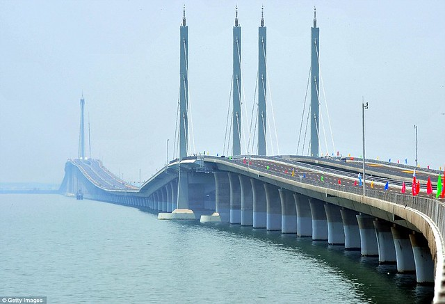 That is a £1bn bridge too far World's longest sea bridge opens to traffic in China... but it will only hold the title for five years  10