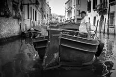 Mr Cab Driver.. (Peter Levi) Tags: street city venice blackandwhite bw italy man blancoynegro water boat canal streetphotography documentary venezia venedig x100 fujifilmx100 fujix100