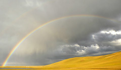 Double Rainbow on Song Kul Lake (keltikee) Tags: iris sky cloud lake color colour rain yellow jaune lago grey gris lluvia rainbow colours earth couleurs hill pluie lac colores line amarillo ciel cielo terre colina nuage arco couleur nube linea arcenciel doble tierra grise
