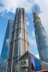 Lujiazui - Image 99 (www.bazpics.com) Tags: china road street new city sculpture building tower tourism skyline museum architecture skyscraper port river bottle construction asia view shanghai jin chinese visit tourist area mao viewpoint financial jinmao opener lujiazui swfc shanghaiworldfinancialcenter