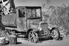 Water Truck (magnetic_red) Tags: truck tank water old rusted rusty abandoned derelict jalopy ford modelt mountains trees desert crowngraphic graflex23 ultrafine400 caffenol