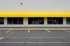 Indy#15273_Copy (Single-Tooth Productions) Tags: storefront abandoned abandonedstorefront composition shapes lines 2d flat yellow parkingspaces emptyparkingspaces outofbusiness architecture architecturalcomposition windows storefrontwindows awning yellowawning empty bleak emptyspace emptyspaces ewashingtonst indianapolis indiana urban city building buildingdetail buildingcomposition 50mm nikkor nikkor50mm nikond200 nikon