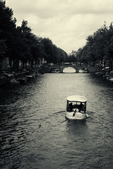 Canal (theHungryPigeon) Tags: amsterdam boat canal bw blackandwhite splittone bridge arch sail water empty journey romance