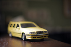 buttery (sgtsalamander) Tags: nikon d800 nikkor 50mmf12 toy car volvo 850 t5r table wood home brown yellow estate wagon