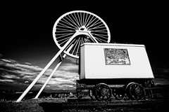 Memorial Wheel Dedication (Graham'M) Tags: blackandwhite monochrome infrared grunge memorial wheel wideangle lowviewpoint samyang focus clouds mine pit staffordshire apedale