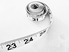 Measure (My TVC 15) Tags: blackandwhite bright time geometry minimal numbers highkey curl hautecouture simple measure counting makingart measuringtape apartmentlife mathy outoftheordinary highkeyish panasonicdmcfh22 23242531