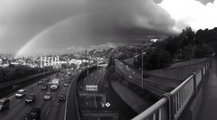 Rainbow in Black and White (striatic) Tags: seattle blackandwhite autostitch panorama cars clouds landscape photo washington rainbow highway day i5 outdoor unitedstatesofamerica overpass interstate stitched stmarkscathedral zymogenetics uploaded:by=flickrmobile flickriosapp:filter=nofilter