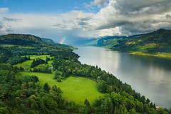 Columbia River Rainbow (Thorsten - www.thorstenscheuermann.com) Tags: trees color green water grass clouds oregon river landscape washington rainbow columbiariver columbiarivergorge roosterrock capehorn