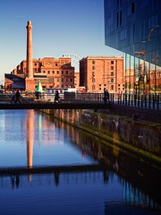 canning dock (khrawlings) Tags: waterfront chimney docks liverpool canning reflection bridge walking pump house water blue