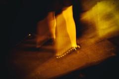 A la lumire des phares (Calinore) Tags: france paris city ville woman femme legs jambes parisienne parisian blur flou pavement trottoir night nuit street rue
