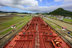 Panama Transit (Zahid - At Sea - Thanks for the favs and comments) Tags: panama outdoor canal panamacanal house boat ships grass highland pipes locomotives sky cloud landscape bridge water aqua hillside waterside road archietecture infrastructure building buildingstructure architecture