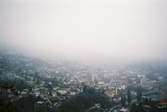 We were lost in the fog of our own insecurities (Karsten Fatur) Tags: landscape city fog mist mountains valley sarajevo bosnia bosniaandherzegovina europe balkans travel adventure explore backpacker film analogue 35mm vintage autumn fall nature cityscape