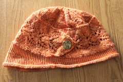 Virginia City Cloche (ChaucerCat) Tags: knit knitting yarn ravelry cloche cowl romi hat scarf lace button leaves orange