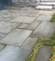 Fossil Spire Snapped Wall Stone & Bushhammered Steps, Bluestone Patterned Flagstone (Natural Cleft) (Buechel Stone) Tags: naturalstone buildingstone stoneveneer thinveneer fullveneer stone buechelstone stoneexterior stonemasonry stonewalls outdoorliving patio stonesteps