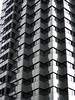 repetitional architecture (doc(q)man) Tags: vertical building windows geometrics geometrical bw blackandwhite monochrome repetition floors highrise abstract pattern surface rhythm barcelona spain structure uniform symmetry symmetrical wall docman