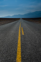 endless highway (Eric C Bryan) Tags: road street blue sky mountains lines clouds landscape nikon highway day cloudy pavement deathvalley filters sapphire d700 ericbryan singhrayfilters leegndfilters ericbryanphotography wwwericbryannet ericcbryan ericbryannet