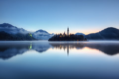 Feeling Blue (TheFella) Tags: longexposure morning blue sun mist reflection slr castle church water misty fog digital photoshop sunrise canon island eos dawn photo high europe dynamic foggy cyan surface explore slovenia photograph hour processing slowshutter bled 5d bluehour slov