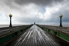 Clevedon Pier & a Welsh Storm 2 (welshio) Tags: light sea england storm water rain wales clouds fence coast pier perspective dramatic stormy estuary severn boardwalk bleak thunder clevedon lampposts bristolchannel endofpier