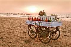 Gollawallas last trade before sundown (arfabita) Tags: ocean old sunset red sea orange sun india color ice beach nature water colors silhouette yellow horizontal set sunrise landscape boats dawn boat lemon fishing globe sand rocks surf waves sundown natural dusk juice trolley sandy horizon relaxing rusty orb slush rockface boulders hues drinks canoes bombay environment glowing leisure vendor local recreation cart rise trade pleasure wala beautyspot vessels streetvendor bouncing nonalcoholic gola trader ices golla arabiansea horizonline manori nicescene manoribel freshlemon slushhpuppy