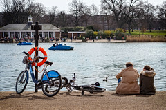 With Bikes by a Lake (garryknight) Tags: lake london bike bicycle restaurant nikon couple lifebelt cycle hydepark serpentine lido pedalo lightroom 50mmf18 d5100 borisbike