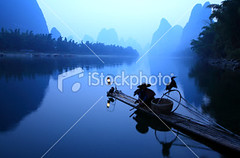 Fishermen-fishing (MPBHAIBO) Tags: china blue light mist mountain reflection water lamp fog sunrise river landscape dawn liriver fishing fisherman asia dusk guilin yangshuo hill bamboo cormorant lantern    chineseculture    ruralscene fishingindustry    lightingequipment karstformation nauticalvessel chineseethnicity woodenraft  guangxiregion