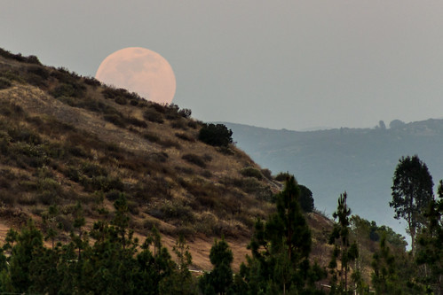 Full moon rising above the mountain