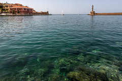 Chania harbor entrance (macropoulos) Tags: sea summer lighthouse sailboat harbor 500v20f calm greece 500v50f crete 1000v100f topf100 canonef2470mmf28lusm gettyimages chania canoneos5d 1500v60f 1000v40f 3000v120f gettyimages:dateadded=20130703