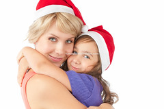 mother and daughter together in christmas hats (Konstantin Yolshin) Tags: christmas family two portrait people woman white holiday cute love girl beautiful beauty smile look hat childhood smiling female studio mom fun happy person navidad kid hugging holding hug couple pretty child looking little background joy daughter young mother lifestyle happiness mum parent together positive cheerful generation isolated hold caucasian