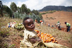 Young baby waits for his mother (World Bank Photo Collection) Tags: community rwanda growth agriculture economy development reform publicpolicy foodsecurity agriculturalinvestment economicplanninganddevelopment prioritydevelopment