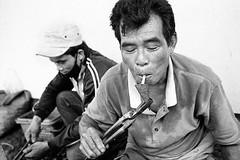 How to lit a cigarette (pacco_racco) Tags: man smoking blacksmith hotironpiece backyard middlemekong northernlaos leicam6 leicasummicron35mmf20asph kodaktrix400