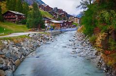 River through Zermatt, Switzerland (` Toshio ') Tags: toshio zermatt switzerland swiss swissalps mattervispa river nature city europe european houses village fujixe2 xe2