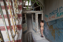 Young and beautiful amid the destruction (gyuri200) Tags: woman posing nude beauty staircase rubbish ruin stand contrast