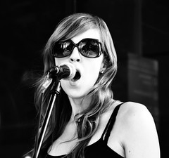 Blues in Black and White (forestforthetress) Tags: blues bluesmusic music woman female girl singer song bw blackandwhite omot nikon glasses gig concert festival streetphotography fridaynightlive champaign