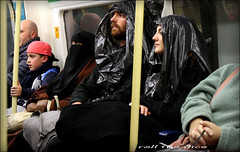 `1844 (roll the dice) Tags: london londonist tube underground people natural streetphotography wisdom scarey creepy spook ghost passengers carriage busy mad sad funny surreal halloween uk art classic urban englnad unaware unknown portrait strangers candid muslim religion witch covered veiled hijab niqab saints pvc binliner fancydress party drinking amazing brave costume haunted pumpkin bomfire islamic window reflection travel transport beard glass pole colour shock reaction yemen burqa pretty eyes girls laughter kid cap fashion tourism canon shopping bored