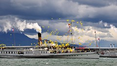 Naval Parade (SLpixeLS) Tags: old sky cloud lake switzerland boat suisse cloudy ballon balloon lac steam parade ciel nuage leman nyon cgn nuageux bteau vapeur navale lcher