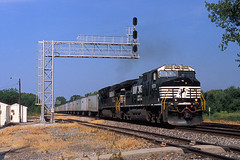 Eastbound Roadrailers at Tolono, IL (CentralILRailfan) Tags: railroad morning bridge sun cn train illinois ns norfolk railway canadian il southern national crown signal triple rejected freight rejection cantilever intermodal tolono roadrailers railpicturesnet railpictures