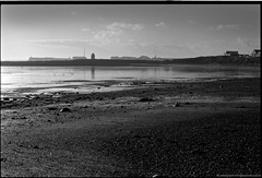 Calm shoreline, Newton, South Wales (Mooganic) Tags: uk bw reflection film beach wales 35mm nikon day kodak harbour cymru shoreline f100 lifeguard calm coney seafront bw400cn