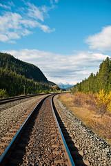 Train Tracks (aitramah) Tags: railroad mountains nature vertical train landscape outdoors traintracks tracks rail bluesky verticalphotography