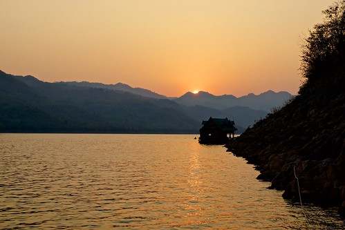 Sunset over the mountains on Srinakarin lake in Kanchanaburi province, Thailand