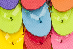 Multicolored flip flops on wooden deck (Jim Corwin's PhotoStream) Tags: abundance brightcolor casual closeup closeups color deck display displayed easygoing enjoyment fashion flipfops footwear fun group groupofobjects horizontal leisureactivity multicolored nobody outdoors overheadview pair pattern patterns photography relaxation relaxing repetition row rows sandal sandals shoes sidebyside stack stacked stilllife summer thongs togetherness topview travel travelandtourism vacation vacations variation viewfromabove