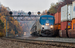 It's Lit at Lilly (Wheelnrail) Tags: amtrak norfolk southern ns amtk pennsylvanian pennsylvania pittsburgh line prr position lights action passenger train trains meet three fall color cloudy day ge p42dc lilly intermodal freight locomotive