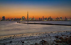 """New """"F""""ormation .. (Almsaeed) Tags: dubai pano blue hour downtown skyline water lake moment reflection curve love sunset uae burj khalifa colors fidaa sands hdr long exposure canon photography rocks outdoor you me only"""