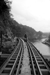 Come with me... (Daniel Nebreda Lucea) Tags: girl mujer chica adventure aventura railway via train tren walk andar walking andando nature naturaleza landscape paisaje asia thailand thailandia asian mountains montañas perspective perspectiva canon 60d black white blanco negro water agua sea river rio kanchanaburi amazing beautiful bonito texture textura shadows sombras lines lineas structure estructura bridge puente jungle jungla architecure arquitectura travel viajar