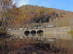 CSX 335 and 850 (Trains & Trails) Tags: n785 coal train railroad scenic mountains bridge stone arch indiancreek youghioghenyriver ac44cw ge yn2 widecab generalelectric brightfuture 335 850 engine locomotive diesel transportation november fall autumn foliage water