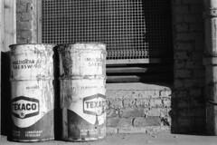 Scan10576cc (citatus) Tags: cans barrels lubricant texaco loading dock york trading company street toronto canada 1970s minolta srt 102 bw sherbourne