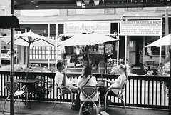 DR1-40-18A (David Swift Photography Thanks for 19 million view) Tags: davidswiftphotography philadelphia southphilly italianmarket streetphotography streetscapes cafeseating candidportrait restaurants 35mm film ilfordxp2 leicaminilux