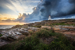 Before the rain (Arvid Bjrkqvist) Tags: mood bua fyr lighthouse dramatic clouds sky sunset rain wind storm coast water sea ocean sweden varberg landmark light rocks cliffs wildflowers canon6d