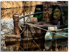 Narrowboat & canoe (lovestruck.) Tags: door uk trees winter england brown colour reflection green texture water grass rural fence countryside boat canal wooden bank rope knot fields crops wiltshire wound knots kennetandavon towpath 2012 hinges narrowboats challengeyouwinner