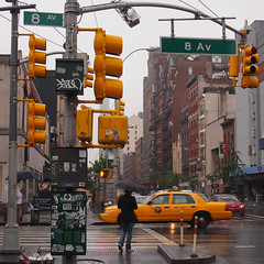 (New Dan) Tags: newyork rain yellow umbrella hotel trafficlight chelsea crossing cab 2013